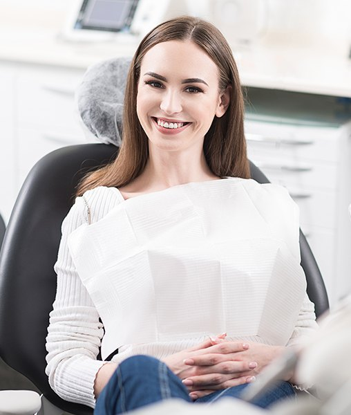 Smiling woman in dental treatment chair