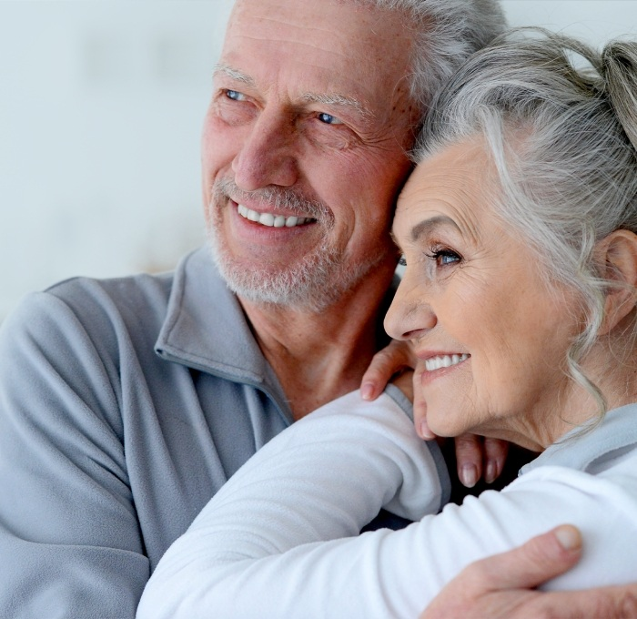 Older man and woman with healthy smiles thanks to the dentist in York Pennsylvania