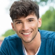 Young man with aligned smile thanks to orthodontics