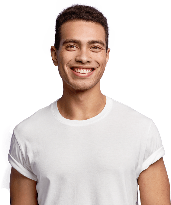 Young man with properly aligned smile after orthodontics
